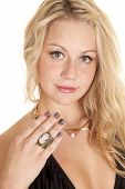 pic of cameos  - A woman looking showing off her cameo ring on her finger - JPG