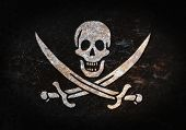stock photo of pirate sword  - Old rusty metal sign with a flag  - JPG