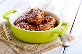 picture of meatballs  - Teriyaki chicken meatballs in a dish on table - JPG