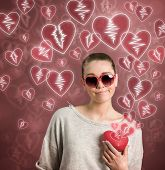 picture of loveless  - young woman holding broken heart - JPG