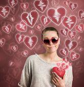 foto of loveless  - young woman holding broken heart - JPG