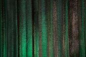 foto of insulator  - Thermal insulation under roof building in night scene reflect wiht green light - JPG