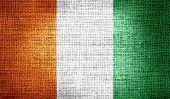 foto of ivory  - Grunge of Ivory Coast flag on burlap fabric - JPG