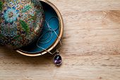 foto of jewel-case  - closeup photo of a beautiful vintage jewelry box on a wooden table - JPG