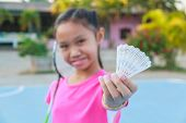 pic of shuttlecock  - Cute little girl holding badminton racket and shuttlecock Outdoor - JPG