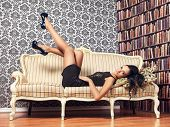 picture of provocative  - young provocative woman lying on couch - JPG