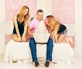 picture of threesome  - happy man with big cake and two women - JPG