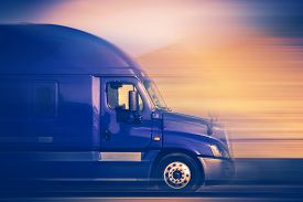 picture of trucks  - Rush Trucking. Speeding Blue Semi Truck on the American Highway. Trucking Concept. ** Note: Soft Focus at 100%, best at smaller sizes - JPG