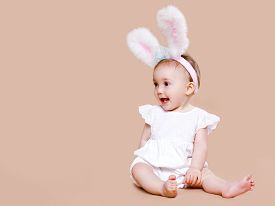 picture of bunny costume  - Cute baby sitting in costume easter bunny - JPG