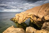 stock photo of tide  - Saddle Rocks at Cullercoats Whitley Bay here at high tide on a cloudy day - JPG
