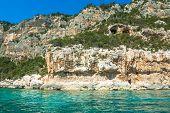 foto of shoreline  - Cala Gonone shoreline on a clear day Sardinia - JPG