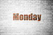 image of monday  - Red Brick wall texture background with a word Monday - JPG