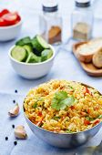 foto of saffron  - saffron rice with vegetables and cilantro on a blue background - JPG