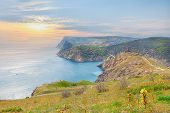 stock photo of crimea  - scenic cliff above the sea during sunset in Balaclava - JPG