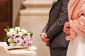 picture of altar  - bride and groom at the altar with bouquet of flowers - JPG