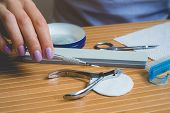 stock photo of manicure  - Manicure set on a wooden table - JPG