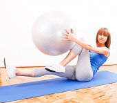 image of pilates  - Fitness girl doing abs exercise with pilates ball - JPG