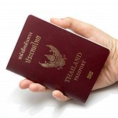 pic of passport cover  - hand holding passport isolated on white background - JPG