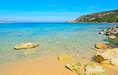 picture of shoreline  - yellow rocks in Capo Testa shoreline Sardinia - JPG
