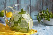 Постер, плакат: Fruit water in glass pitcher