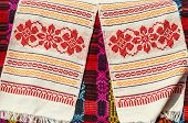 stock photo of hillbilly  - Belorussian towels with traditional ornaments on the background a bright colored rustic bedcover - JPG