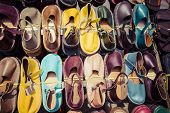 pic of flea  - Leather shoes in different colors at a flea market - JPG