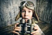 image of binoculars  - Boy plays the pilot - JPG