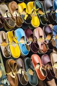 image of flea  - Leather shoes in different colors at a flea market - JPG