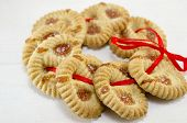 image of apricot  - Tea biscuits filled with apricot jam on white background connected with a red ribbon - JPG