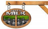 pic of milk  - Wooden sign with text Fresh milk steel cans for the transport of milk on green grass - JPG