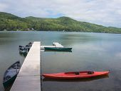 foto of pier a lake  - pier with canoes and kayak  on lake - JPG