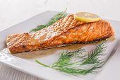 stock photo of salmon steak  - Salmon steak on white plate - JPG