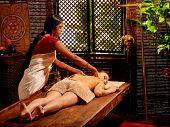 stock photo of panchakarma  - Young caucaswian woman having oil India spa treatment - JPG
