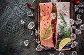 foto of salmon steak  - Delicious salmon steak on stone table - JPG