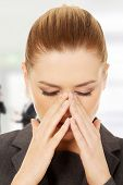 image of sinuses  - Young businesswoman suffering from sinus pain - JPG