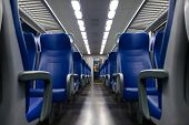 pic of passenger train  - Perspective view of seats from the aisle inside a passenger train - JPG