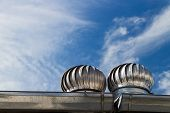 stock photo of ventilator  - Roof Ventilation on blue sky and cloud background - JPG