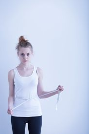 picture of anorexic  - Image of anorexic girl measuring her waist - JPG
