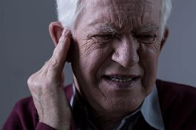 pic of suffering  - Old man suffer from tinnitus - JPG