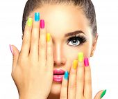 Beauty Girl Face with Colorful Nail polish. Colourful Studio Shot of young Woman. Vivid Colors. Colo poster