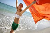 Beautiful young woman at the beach with pareo poster