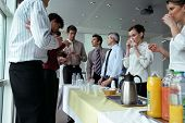 picture of matinee  - Men and women having a drink at work - JPG