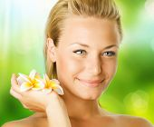 stock photo of beautiful flower  - Spa Girl over nature background - JPG