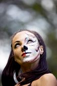pic of tigress  - young woman with tigress face art look up - JPG