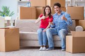 Young pair moving in to new house with boxes poster
