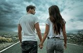 Conceptual photo of a young couple over an empty road poster