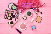 Fashion Makeup Essentials, Wooden Background. Makeup And Cosmetic Set, Top View. Female Stylish Make poster
