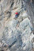 A Woman Climber On A Rock. poster
