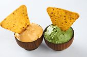 Nachos With Cheese And Guacamole Sauce In Wooden Bowls Isolated On White Background With Copy Space, poster