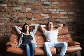 Young Happy Couple Relaxing On Comfortable Leather Couch At Home, Relaxed Smiling Man And Woman Rest poster